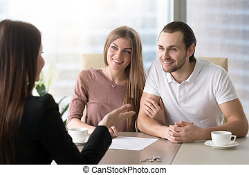 Couple applying for mortgage, taking bank loan to buy property