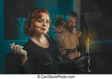 Retro girl with a candle. - Redhead retro girl with a candle...