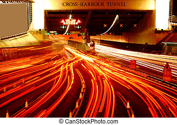 busy traffic hour in cross harbour tunnel at night