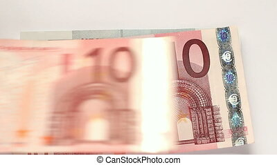 Stacking lots of Euro notes. - Stacking lots of different...