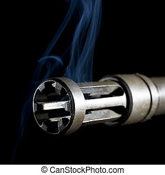 smoking barrel - flash hider on an assault rifle that is...