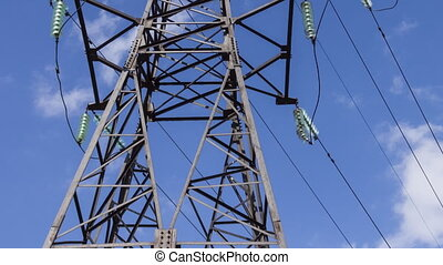Full-sized electric support with high-voltage wires. Vertical panorama. Renewable energy sources, electrical networks, substations and generators.