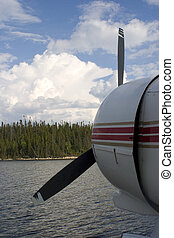 approaching storm - float plane parked at a dock as a storm...