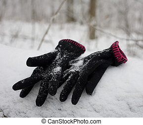 lost mittens - childs black mittens that are discarded in...