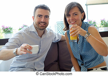 Couple having breakfast in hotel during vacations
