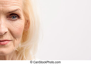 Interested glance of old woman