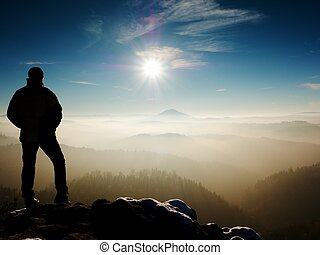 Man silhouette on sharp peak. Satisfy hiker enjoy view - Man...