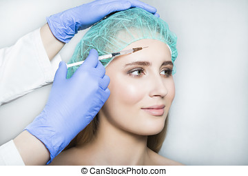 Doctor aesthetician makes face beauty injections to female...