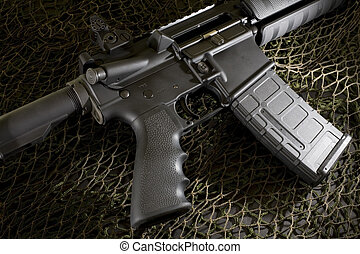 AR15 - Assuaulte rifle that is on black and white netting