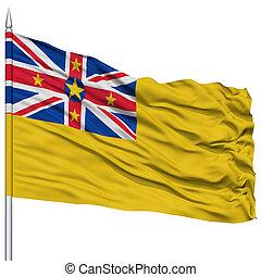 Niue City Flag on Flagpole, Capital City of Alofi, Flying in...