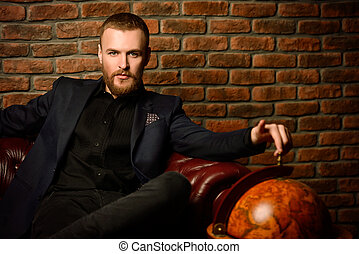 secured life style - Imposing well dressed man sitting on a...