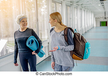 Cheerful retiree telling with smiling female - Outgoing...