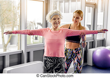 Outgoing beneficiary doing workout in fitness center -...