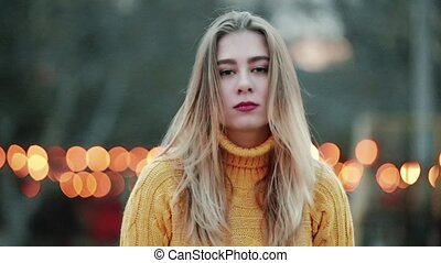Portrait Beautiful blond looks at the camera never taking her eyes off angry expression Emotionless