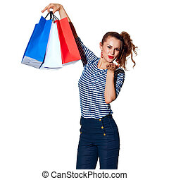 trendy woman with shopping bags on white blowing air kiss -...