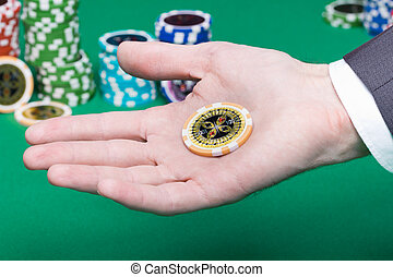 poker chips in the palm of a man