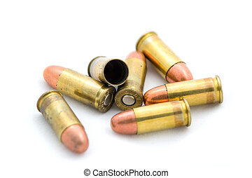 Bullets - A photo of a pile of bullets set against a white...
