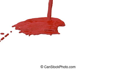 Flow of red paint splattering on white background and...