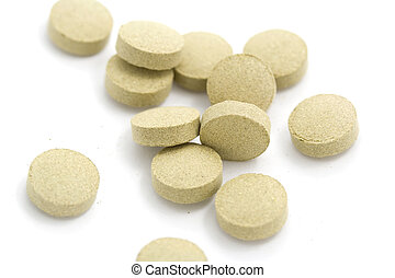 Pile of Tablets - A photo of a pile of tablets set against a...