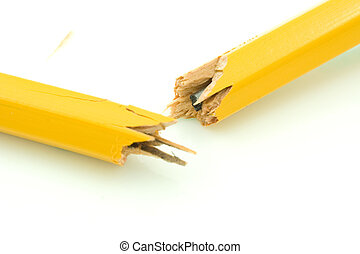 Broken Pencil - A photo of a yellow broken pencil set...