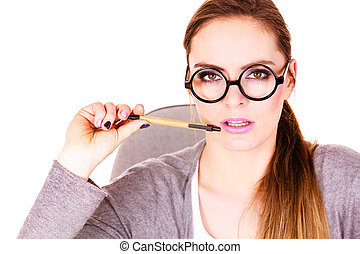 Woman thinking holds pen - Attractive woman thinking seeks a...