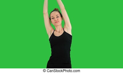 Young pretty woman have yoga practice on a Green Screen,...
