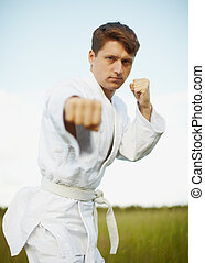 Young man is engaged in karate