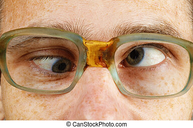Cross-eyed person in old-fashioned spectacles - The...