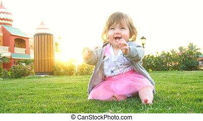 Happy cute baby in park - Happy adorable cute baby in park...