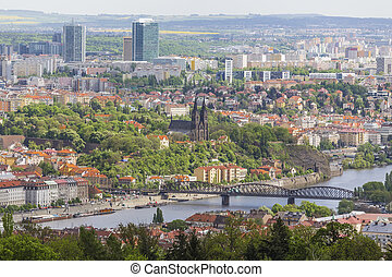 View from Petrin hill to Vyshehrad and remote modern...