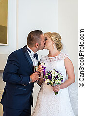 Loving couple in the registry office - Man and woman kissing...