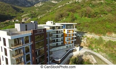 Multi-storey house in the mountains. Montenegrin architecture. P
