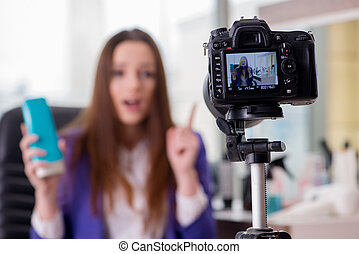 Beauty fashion blogger recording video for blog