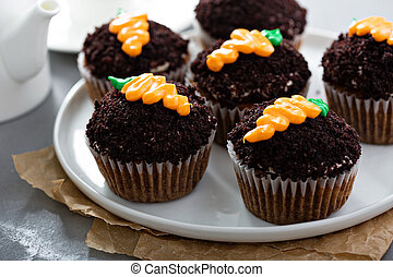 Carrot cupcakes with chocolate crumbs and frosting