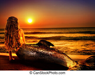 Woman mermaid dreams on sea sandy beach. Fairy girl - Water...
