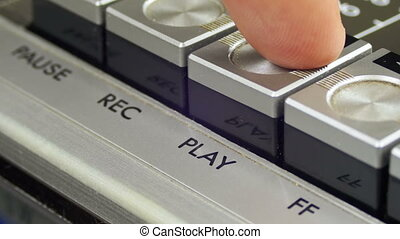 Pushing Play Button on a Vintage Tape Recorder. Close-up....