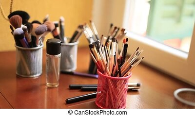 Professional make-up tools. A set of brushes, lipsticks,...