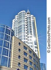 Lofty white building against sky - The modern habitant...