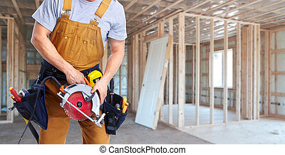 Construction worker with electric saw - construction worker...