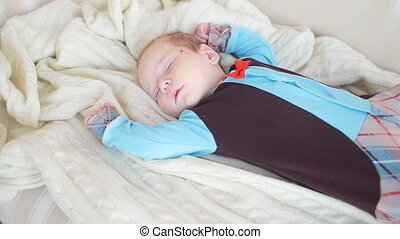 Baby is sleeping on the couch - Cute Baby is sleeping on the...