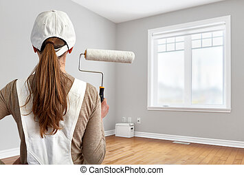 Painter woman with painting roller