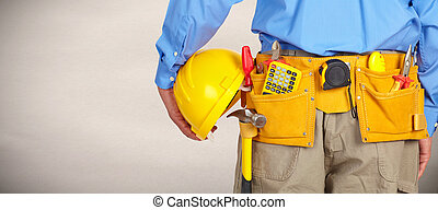 Construction worker with a tool belt.