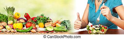 Woman eating salad - Young beautiful woman eating fruits and...
