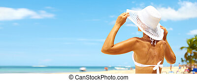 Woman on the beach - Beautiful girl in hat on beach and blue...