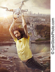 Conceptual portrait of a man flying with a drone