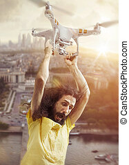 Portrait of a funny guy flying with a drone