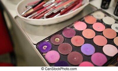 Professional make-up tools. A set of brushes, lipsticks,...