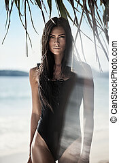 Pretty brunette lady on the tropical beach