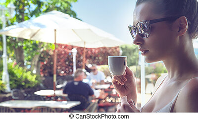 Portrait of an attractive lady drinking a coffee