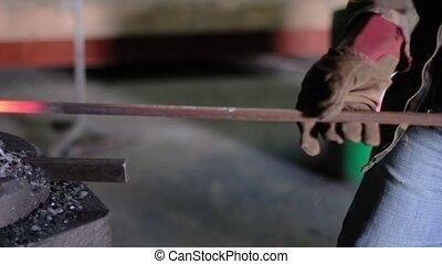 Using Pneumatic Hammer to Shape Hot Metal. Ukraine